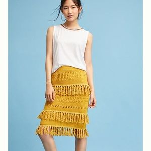 Anthropologie mustard yellow fringe skirt.